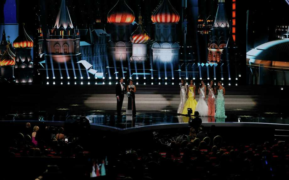 Hosts Thomas Roberts and Melanie Brown, or Mel B, talk to audience as Miss Venezuela Gabriela Isler, Miss Philippines Ariella Arida, Miss Spain Patricia Yurena Rodriguez, Miss Brazil Jakelyne Oliveira and Miss Ecuador Constanza Baez listen during the 2013 Miss Universe pageant in Moscow, Russia, on Saturday, Nov. 9, 2013. Photo: Pavel Golovkin, AP / AP
