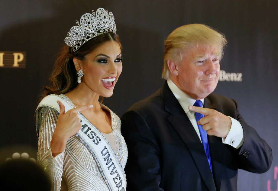 Miss Universe 2013 Gabriela Isler, from Venezuela, left, and pageant owner Donald Trump point to each other while posing for a photo after the 2013 Miss Universe pageant in Moscow, Russia, on Saturday, Nov. 9, 2013. The pageant was held at Crocus City Hall in the Moscow suburb Krasnogorsk. Photo: Ivan Sekretarev, AP / AP2013