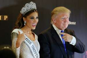 Miss Universe 2013 Gabriela Isler, from Venezuela, left, and pageant owner Donald Trump, of the United States, point to each other while posing for a photo after the 2013 Miss Universe pageant in Moscow, Russia, on Saturday, Nov. 9, 2013.