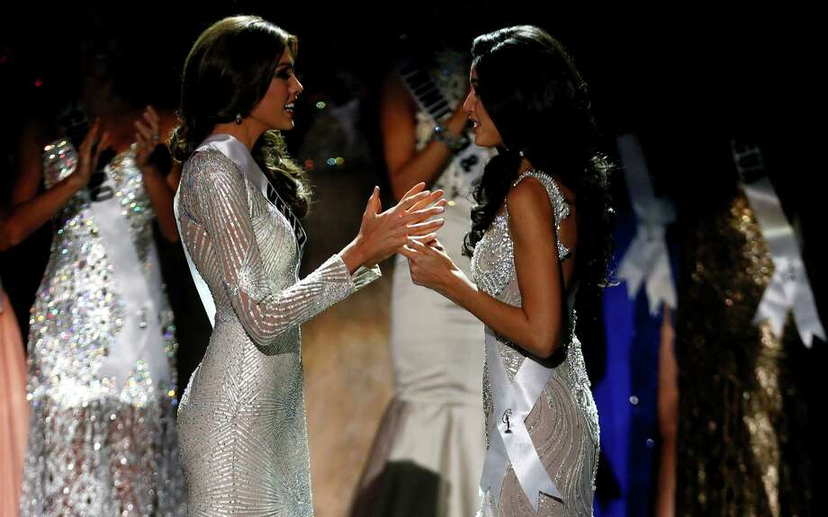 Miss Venezuela Gabriela Isler, left, and Miss Spain Patricia Yurena Rodriguez wait for the judges final decision during the 2013 Miss Universe pageant in Moscow, Russia, on Saturday, Nov. 9, 2013. Gabriela Isler won the Miss Universe 2013 title. Photo: Pavel Golovkin, AP / AP