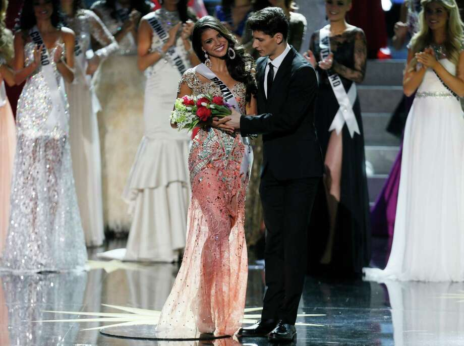 Miss Brazil Jakelyne Oliveira, left, receives a bouquet of flowers before leaving the 2013 Miss Universe pageant in Moscow, Russia, Saturday, Nov. 9, 2013. Gabriela Isler won the Miss Universe 2013 title. Photo: Pavel Golovkin, AP / AP2013