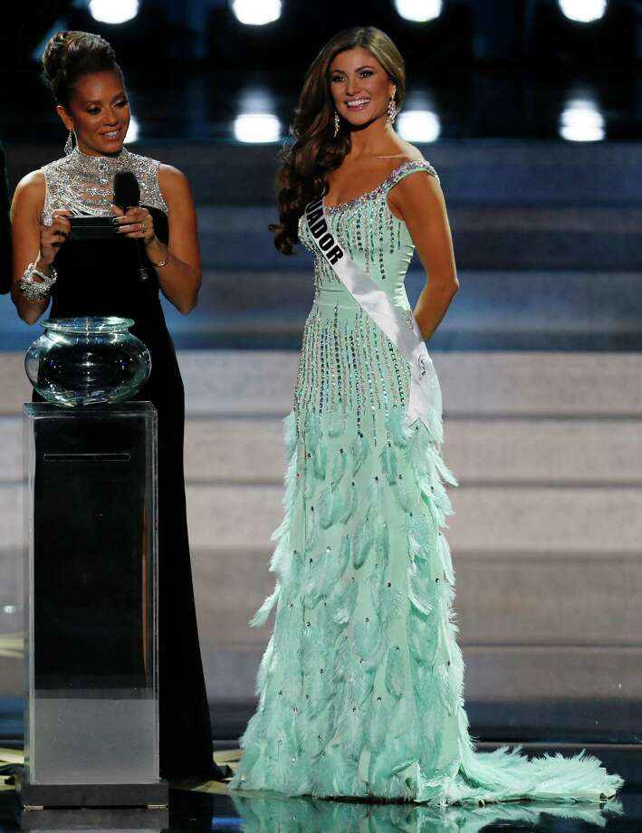Miss Ecuador Constanza Baez, right, answers questions as she participates in the 2013 Miss Universe pageant in Moscow, Russia, Saturday, Nov. 9, 2013. At left is host Melanie Brown, or Mel B. Photo: Pavel Golovkin, AP / AP