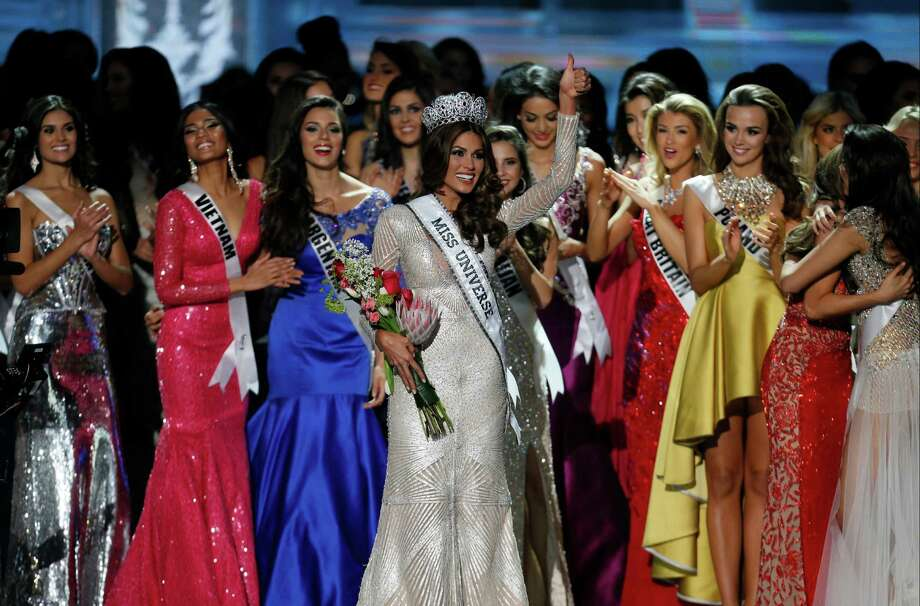 Miss Universe 2013 Gabriela Isler, from Venezuela, center, gestures after winning the 2013 Miss Universe pageant in Moscow, Russia, Saturday, Nov. 9, 2013. Photo: Pavel Golovkin, AP / AP2013