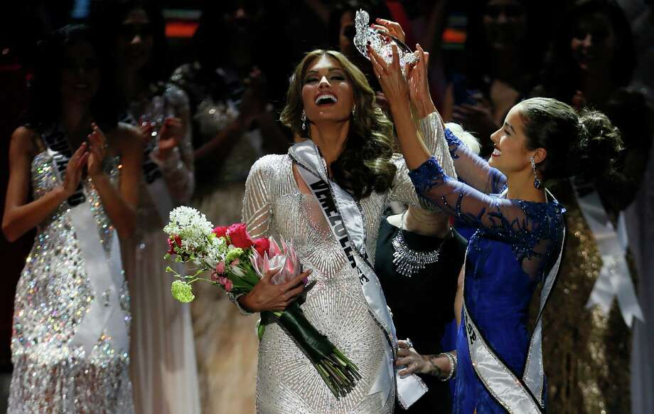 Miss Universe 2012 Olivia Culpo, from the United States, right, places the crown on Miss Venezuela Gabriela Isler during the 2013 Miss Universe pageant in Moscow, Russia, Saturday, Nov. 9, 2013. Photo: Pavel Golovkin, AP / AP2013