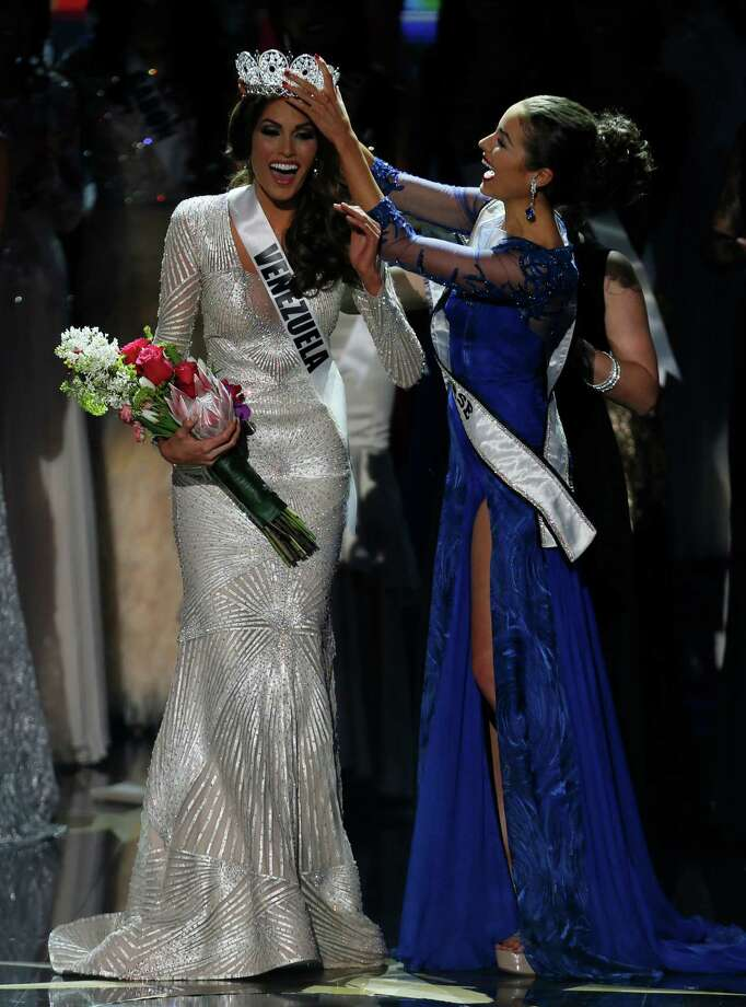 Miss Universe 2012 Olivia Culpo, from the United States, right, places the crown on Miss Venezuela Gabriela Isler during the 2013 Miss Universe pageant in Moscow, Russia, on Saturday, Nov. 9, 2013. Photo: Pavel Golovkin, AP / AP2013