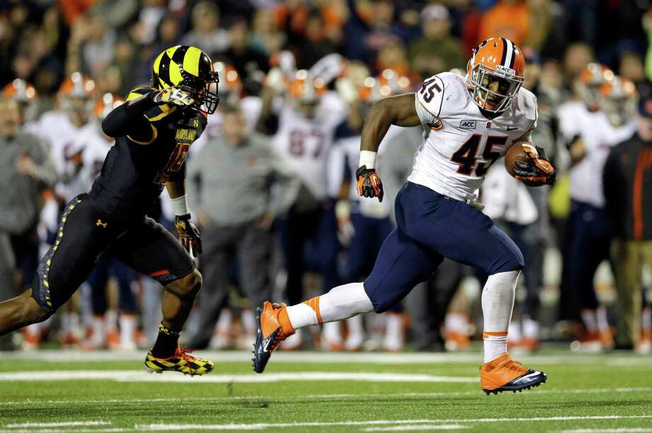 Syracuse running back Jerome Smith, right, outruns Maryland defensive back A.J. Hendy as he scores a touchdown in the second half of an NCAA college football game in College Park, Md., Saturday, Nov. 9, 2013. Syracuse won 20-3. (AP Photo/Patrick Semansky) ORG XMIT: MDPS109 Photo: Patrick Semansky / AP
