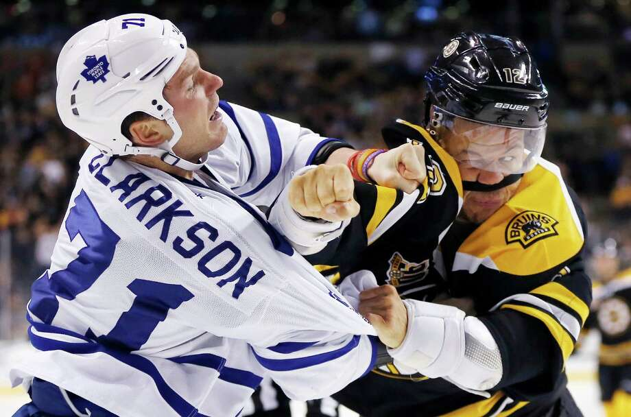 Toronto Maple Leafs' David Clarkson (71) and Boston Bruins' Jarome Iginla (12) fight in the second period of an NHL hockey game in Boston, Saturday, Nov. 9, 2013. (AP Photo/Michael Dwyer) ORG XMIT: MAMD106 Photo: Michael Dwyer / AP