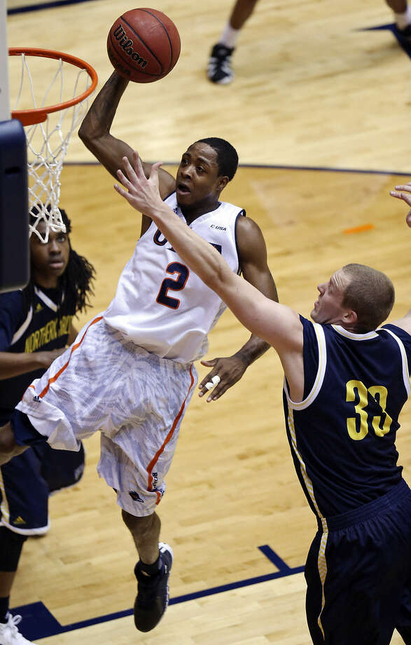 UTSA's Hyjii Thomas, who had a career-high 17 points with six rebounds, soars to the basket around Northern Arizona's Max Jacobsen (33) during the first half Saturday at the Convocation Center. Photo: Edward A. Ornelas / San Antonio Express-News