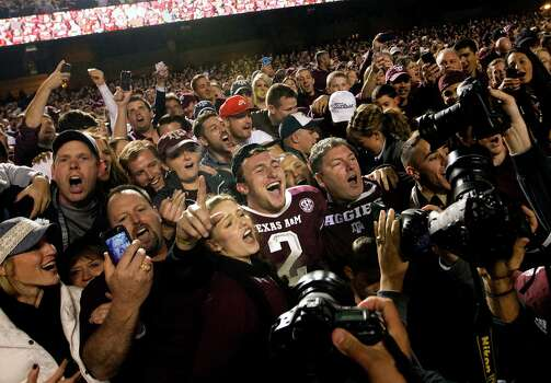 Johnny Manziel (2) becomes a man of the people after the Aggies won Saturday in what could be the sophomore quarterback's final game at Kyle Field. Photo: Cody Duty, Staff / © 2013 Houston Chronicle