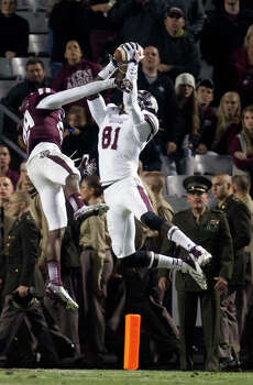 Mississippi State's De'Runnya Wilson, right, outjumps A&M's Deshazor Everett for a TD reception. Photo: Cody Duty, Staff / © 2013 Houston Chronicle