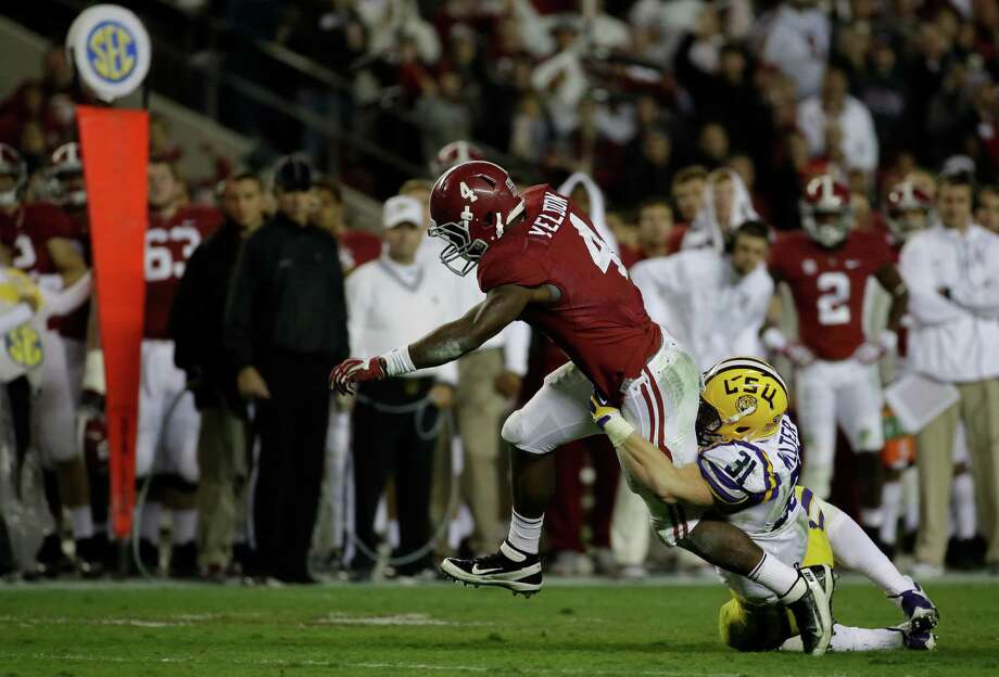 Alabama running back T.J. Yeldon proves difficult for LSU linebacker D.J. Welter to bring down. Photo: Dave Martin, STF / AP