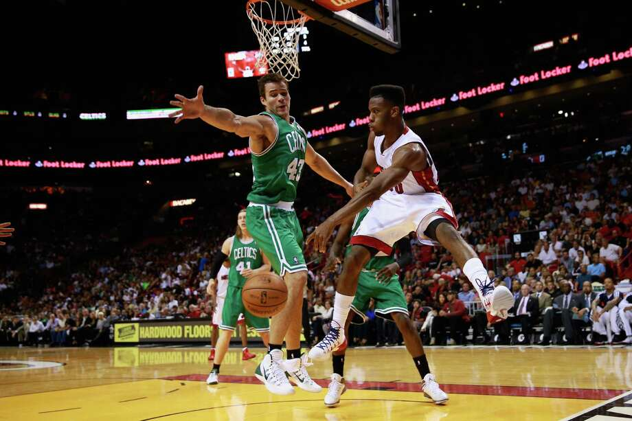 MIAMI, FL - NOVEMBER 09: Norris Cole #30 of the Miami Heat attempts to pass the ball under pressure from Kris Humphries #43 of the Boston Celtics at American Airlines Arena on November 9, 2013 in Miami, Florida. NOTE TO USER: User expressly acknowledges and agrees that, by downloading and or using this photograph, User is consenting to the terms and conditions of the Getty Images License Agreement. (Photo by Chris Trotman/Getty Images) ORG XMIT: 182407465 Photo: Chris Trotman / 2013 Getty Images