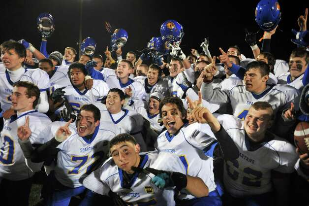Queensbury players celebrate their victory over Burnt Hills in the Class A Super Bowl at Shenendehowa High School Saturday Nov. 9, 2013, in Clifton Park, NY.  (John Carl D'Annibale / Times Union) Photo: John Carl D'Annibale / 00024545A