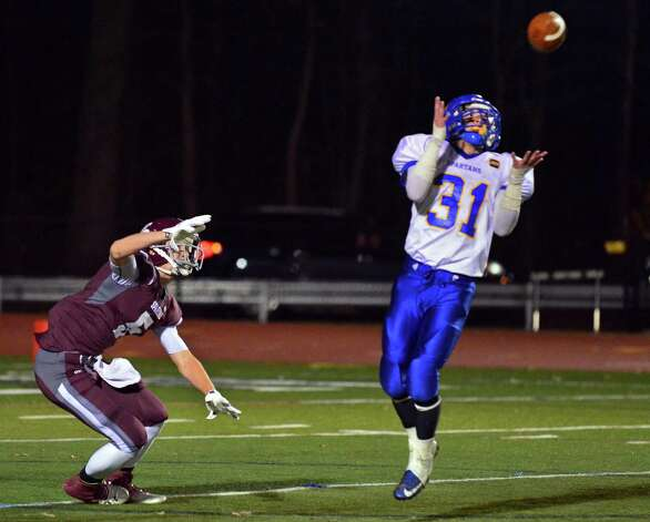 Queensbury's #31 Erik Wettersten intercepts a pass meant for Burnt Hills' #5 Patrick Brown  during the Class A Super Bowl at Shenendehowa High School Saturday Nov. 9, 2013, in Clifton Park, NY.  (John Carl D'Annibale / Times Union) Photo: John Carl D'Annibale / 00024545A