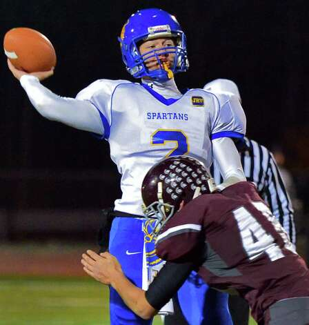 Queensbury QB #2 Aidan Switzer gets off a pass during the Class A Super Bowl against Burnt Hills at Shenendehowa High School Saturday Nov. 9, 2013, in Clifton Park, NY.  (John Carl D'Annibale / Times Union) Photo: John Carl D'Annibale / 00024545A