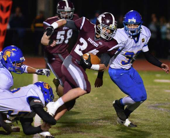 Burnt Hills' #24 Daniel Joshua Quesada pulls away from Queensbury's defense during the Class A Super Bowl at Shenendehowa High School Saturday Nov. 9, 2013, in Clifton Park, NY.  (John Carl D'Annibale / Times Union) Photo: John Carl D'Annibale / 00024545A
