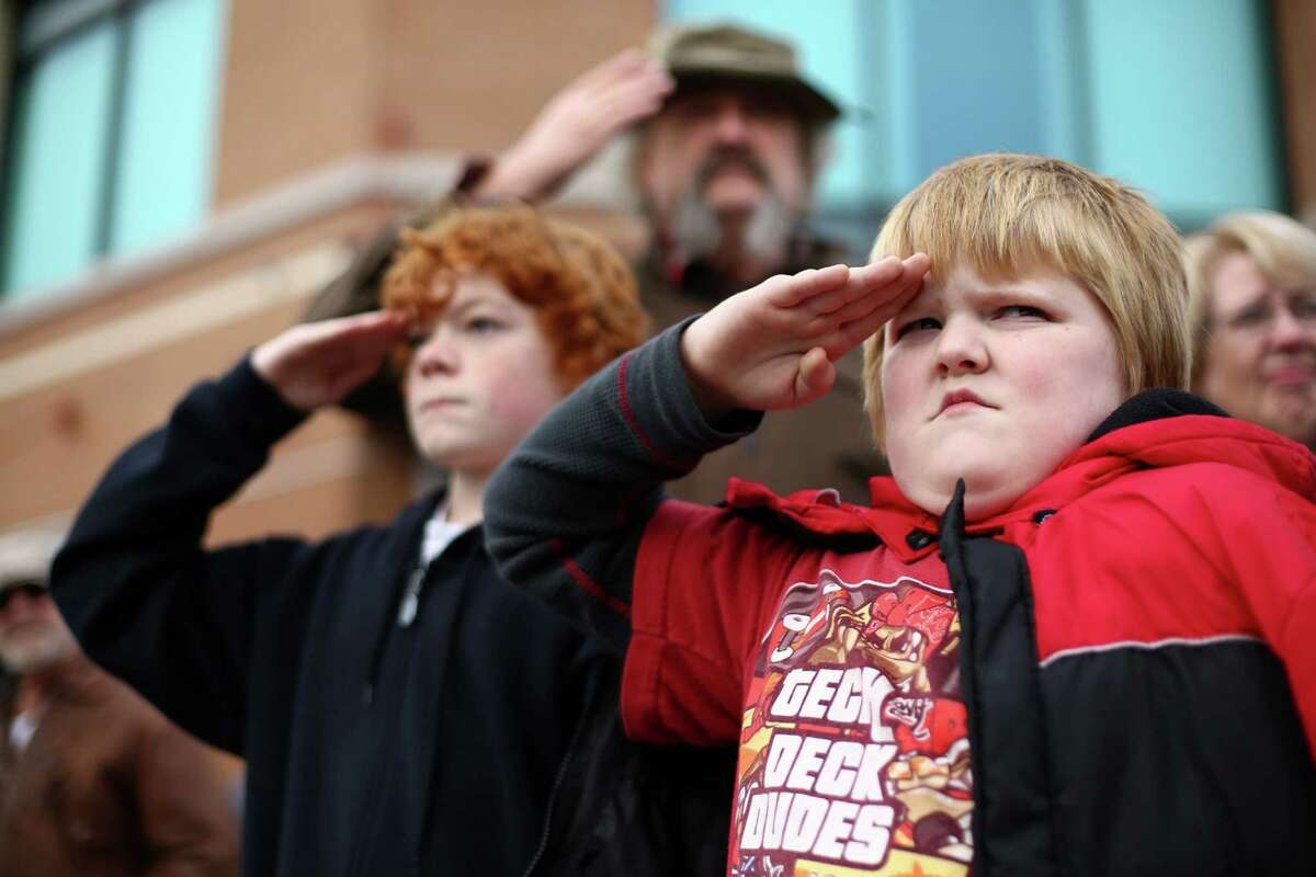John Baker, 8, offers his best salute as the flag passes during the 48th annual Auburn Veterans Day Parade in downtown Auburn. The parade is one of the largest parades to honor veterans in the country.