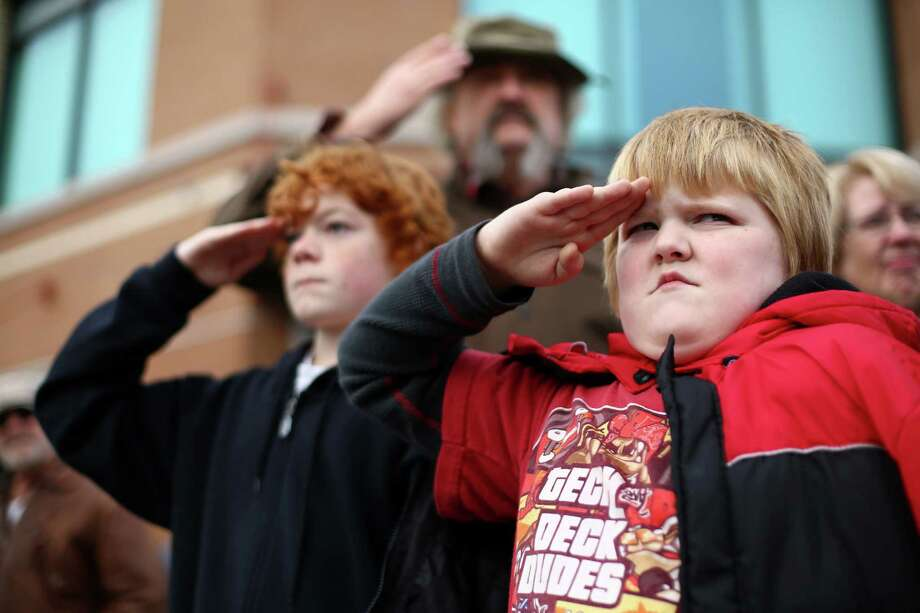 John Baker, 8, offers his best salute as the flag passes during the 48th annual Auburn Veterans Day Parade in downtown Auburn. The parade is one of the largest parades to honor veterans in the country. Photo: JOSHUA TRUJILLO, SEATTLEPI.COM / SEATTLEPI.COM