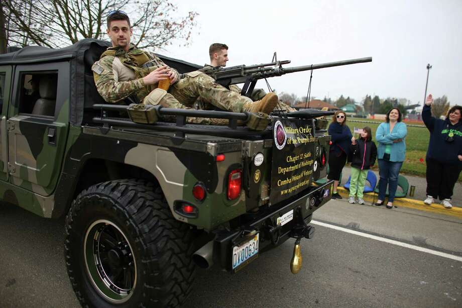 Members of the Military Order of the Purple Heart ride on the back of a Hummer during the 48th annual Auburn Veterans Day Parade. Photo: JOSHUA TRUJILLO, SEATTLEPI.COM / SEATTLEPI.COM