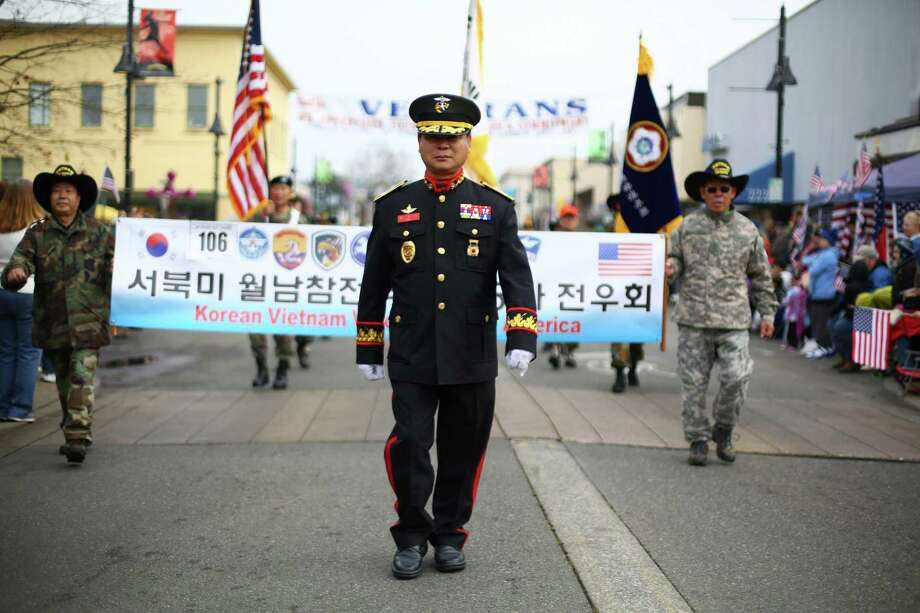Members of the Korean Vietnam Veterans of America march during the 48th annual Auburn Veterans Day Parade. Photo: JOSHUA TRUJILLO, SEATTLEPI.COM / SEATTLEPI.COM