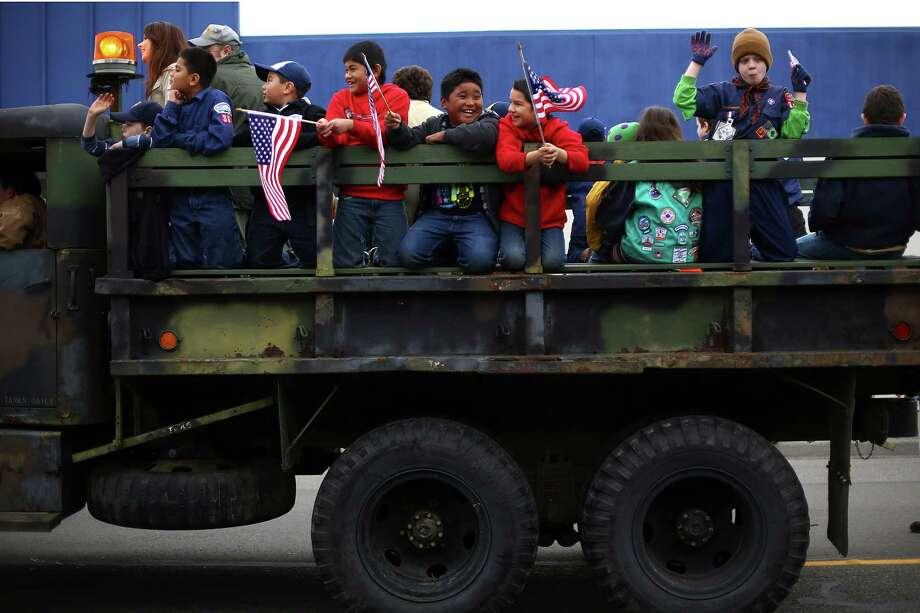 Cub Scouts ride in a truck during the 48th annual Auburn Veterans Day Parade. Photo: JOSHUA TRUJILLO, SEATTLEPI.COM / SEATTLEPI.COM