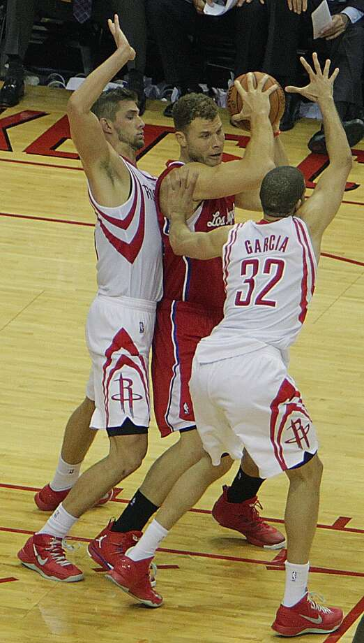 Rockets small forward Chandler Parsons left, and Rockets shooting guard Francisco Garcia double team Clippers power forward Blake Griffin. Photo: James Nielsen, Houston Chronicle