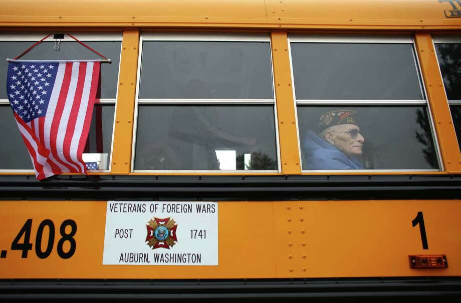 Veteran Robert Lee, Sr. rides in a bus with Veterans of Foreign Wars during the 48th annual Auburn Veterans Day Parade. Photo: JOSHUA TRUJILLO, SEATTLEPI.COM / SEATTLEPI.COM