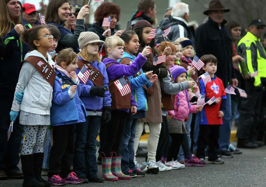 Girl Scout members cheer during the 48th annual Auburn Veterans Day Parade. Photo: JOSHUA TRUJILLO, SEATTLEPI.COM / SEATTLEPI.COM