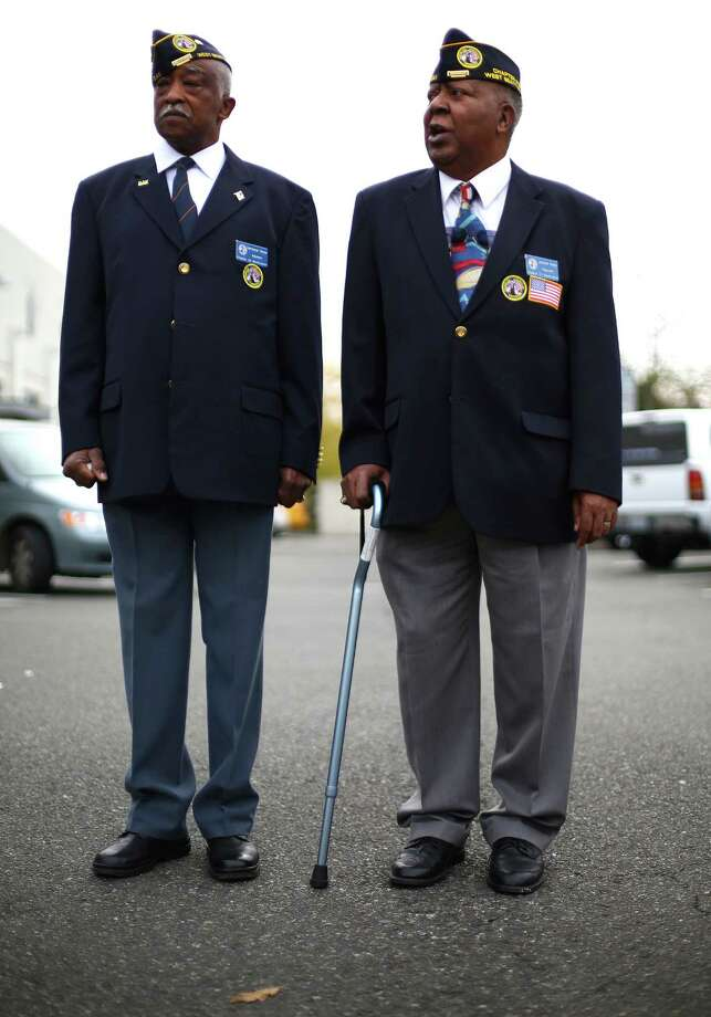 Veterans Surronnal Tanner, left, and Leonard Young stand at attention during the 48th annual Auburn Veterans Day Parade. Photo: JOSHUA TRUJILLO, SEATTLEPI.COM / SEATTLEPI.COM