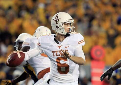 Texas quarterback Case McCoy (6) throw to a receiver during the first quarter of an NCAA college football game against West Virginia in Morgantown, W.Va., on Saturday, Nov. 9, 2013. (AP Photo/Christopher Jackson) Photo: Chris Jackson, Associated Press