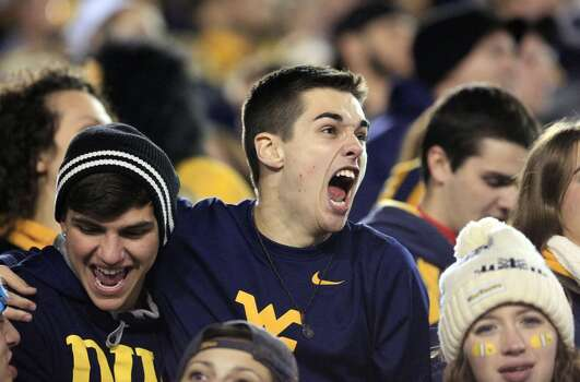 West Virginia fans cheer in the student section during the second quarter of an NCAA college football game against Texas in Morgantown, W.Va., on Saturday, Nov. 9, 2013. Texas won 47-40 in overtime. (AP Photo/Christopher Jackson) Photo: Chris Jackson, Associated Press