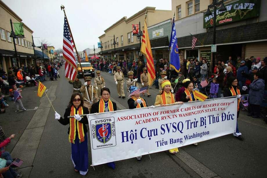 Participants march during the 48th annual Auburn Veterans Day Parade. Photo: JOSHUA TRUJILLO, SEATTLEPI.COM / SEATTLEPI.COM