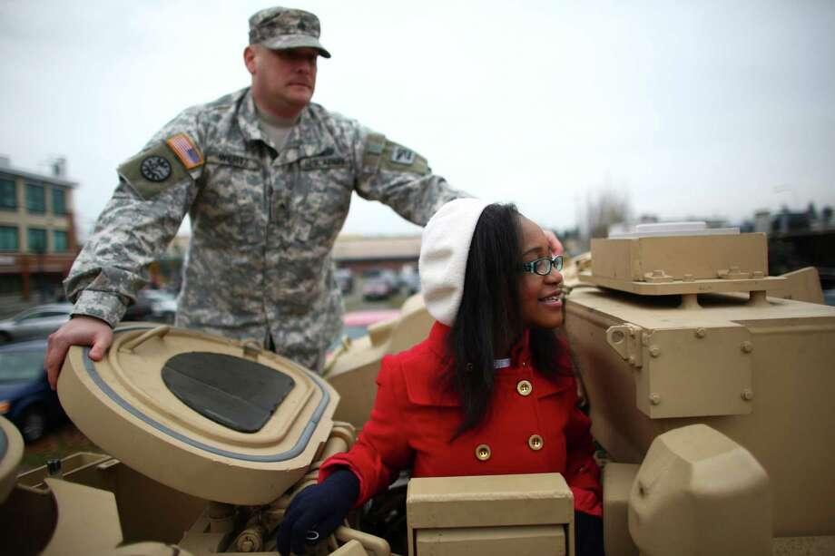 Sylvia Jones, 14, pokes her head out of the turret of a M2A2 Bradley fighting vehicle during the 48th annual Auburn Veterans Day Parade. Photo: JOSHUA TRUJILLO, SEATTLEPI.COM / SEATTLEPI.COM