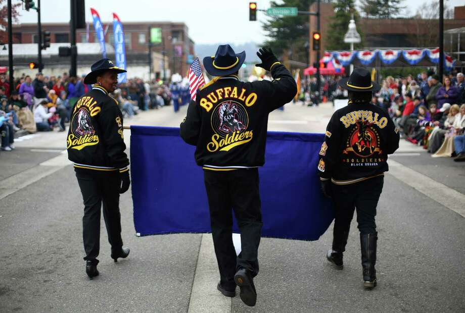 Members of the Buffalo Soliders march during the 48th annual Auburn Veterans Day Parade. Photo: JOSHUA TRUJILLO, SEATTLEPI.COM / SEATTLEPI.COM
