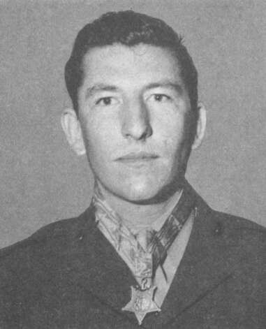 Sergeant William G. Harrell 1922-1964World War IISergeant, U.S. Marine Corps, 1st Battalion, 28th Marines, 5th Marine DivisionIwo Jima, Volcano Islands, 3 March 1945For conspicuous gallantry and intrepidity at the risk of his life above and beyond the call of duty as leader of an assault group attached to the 1st Battalion, 28th Marines, 5th Marine Division during hand-to-hand combat with enemy Japanese at Iwo Jima, Volcano Islands, on 3 March 1945. Standing watch alternately with another marine in a terrain studded with caves and ravines, Sgt. Harrell was holding a position in a perimeter defense around the company command post when Japanese troops infiltrated our lines in the early hours of dawn. Awakened by a sudden attack, he quickly opened fire with his carbine and killed 2 of the enemy as they emerged from a ravine in the light of a star shellburst. Unmindful of his danger as hostile grenades fell closer, he waged a fierce lone battle until an exploding missile tore off his left hand and fractured his thigh. He was vainly attempting to reload the carbine when his companion returned from the command post with another weapon. Wounded again by a Japanese who rushed the foxhole wielding a saber in the darkness, Sgt. Harrell succeeded in drawing his pistol and killing his opponent and then ordered his wounded companion to a place of safety. Exhausted by profuse bleeding but still unbeaten, he fearlessly met the challenge of 2 more enemy troops who charged his position and placed a grenade near his head. Killing 1 man with his pistol, he grasped the sputtering grenade with his good right hand, and, pushing it painfully toward the crouching soldier, saw his remaining assailant destroyed but his own hand severed in the explosion. At dawn Sgt. Harrell was evacuated from a position hedged by the bodies of 12 dead Japanese, at least 5 of whom he had personally destroyed in his self-sacrificing defense of the comma Photo: 1996-98 AccuSoft Inc., All Rights Reserved, U.S. N