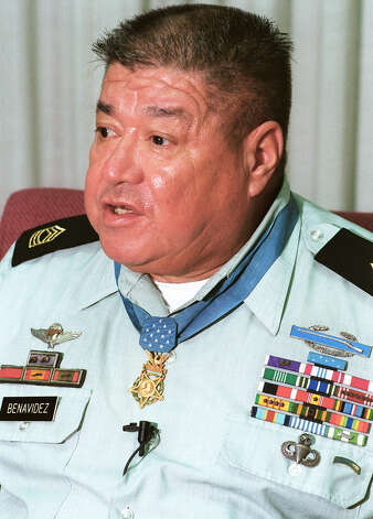 Master Sergeant Roy P. Benavidez, 1935-1998Vietnam WarStaff Sergeant, U.S. Army, Detachment B-56, 5th Special Forces GroupWest of Loc Ninh on 2 May 1968 Master Sergeant (then Staff Sergeant) Roy P. Benavidez United States Army, who distinguished himself by a series of daring and extremely valorous actions on 2 May 1968 while assigned to Detachment B56, 5th Special Forces Group (Airborne), 1st Special Forces, Republic of Vietnam. On the morning of 2 May 1968, a 12-man Special Forces Reconnaissance Team was inserted by helicopters in a dense jungle area west of Loc Ninh, Vietnam to gather intelligence information about confirmed large-scale enemy activity. This area was controlled and routinely patrolled by the North Vietnamese Army. After a short period of time on the ground, the team met heavy enemy resistance, and requested emergency extraction. Three helicopters attempted extraction, but were unable to land due to intense enemy small arms and anti-aircraft fire. Sergeant Benavidez was at the Forward Operating Base in Loc Ninh monitoring the operation by radio when these helicopters returned to off-load wounded crewmembers and to assess aircraft damage. Sergeant Benavidez voluntarily boarded a returning aircraft to assist in another extraction attempt. Realizing that all the team members were either dead or wounded and unable to move to the pickup zone, he directed the aircraft to a nearby clearing where he jumped from the hovering helicopter, and ran approximately 75 meters under withering small arms fire to the crippled team. Prior to reaching the team's position he was wounded in his right leg, face, and head. Despite these painful injuries, he took charge, repositioning the team members and directing their fire to facilitate the landing of an extraction aircraft, and the loading of wounded and dead team members. He then threw smoke canisters to direct the aircraft to the team's position. Despite his severe w Photo: Bob Owen, San Antonio Express-News / SAN ANTON