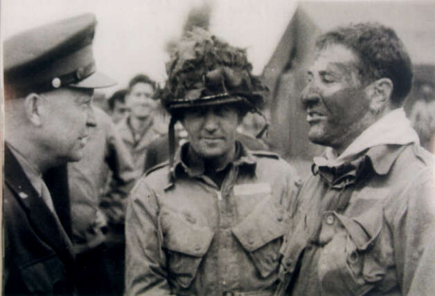 Lieutenant Colonel Robert G. Cole 1915-1944(Right)World War IILieutenant Colonel, U.S. Army, 101st Airborne Division Near Carentan, France, 11 June 1944For gallantry and intrepidity at the risk of his own life, above and beyond the call of duty on 11 June 1944, in France. Lt. Col. Cole was personally leading his battalion in forcing the last 4 bridges on the road to Carentan when his entire unit was suddenly pinned to the ground by intense and withering enemy rifle, machinegun, mortar, and artillery fire placed upon them from well-prepared and heavily fortified positions within 150 yards of the foremost elements. After the devastating and unceasing enemy fire had for over 1 hour prevented any move and inflicted numerous casualties, Lt. Col. Cole, observing this almost hopeless situation, courageously issued orders to assault the enemy positions with fixed bayonets. With utter disregard for his own safety and completely ignoring the enemy fire, he rose to his feet in front of his battalion and with drawn pistol shouted to his men to follow him in the assault. Catching up a fallen man's rifle and bayonet, he charged on and led the remnants of his battalion across the bullet-swept open ground and into the enemy position. His heroic and valiant action in so inspiring his men resulted in the complete establishment of our bridgehead across the Douve River. The cool fearlessness, personal bravery, and outstanding leadership displayed by Lt. Col. Cole reflect great credit upon himself and are worthy of the highest praise in the military service.  Photo: Courtesy Photo / Bruce Cole