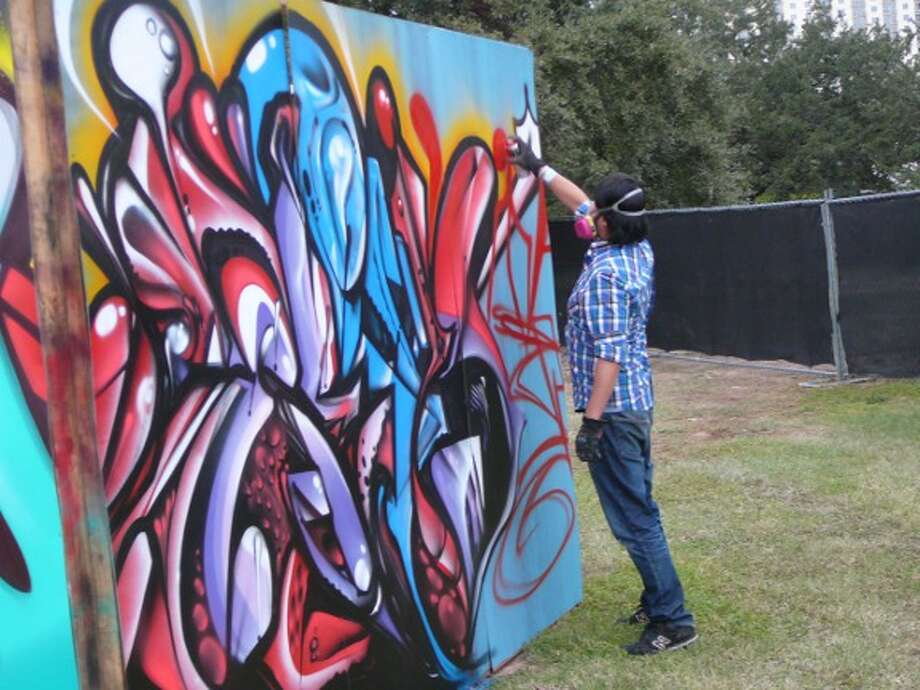 A graffiti artist at work. Photo: Jim Kiest