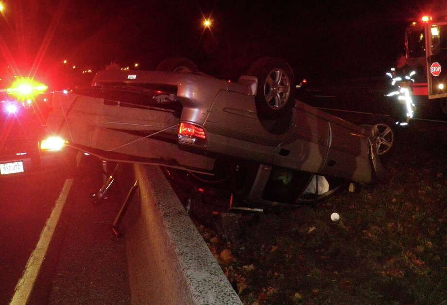 This car flipped over between Interstate 95 exits 16 and 17 early Sunday, but the driver appeared to be uninjured. Photo: Westport Fire Department / Westport News contributed