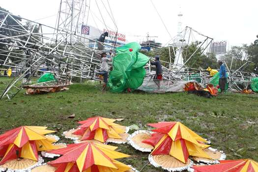 In this Nov. 8, 2013 photo, a gigantic Christmas tree is toppled by strong wind caused by typhoon Haiyan, at Fuente Osmena Circle, Cebu, Philippines. Typhoon Haiyan, one of the most powerful storms on record, slammed into six central Philippine islands on Friday, leaving a wide swath of destruction and scores of people dead. Photo: Chester Baldicantos, AP / AP