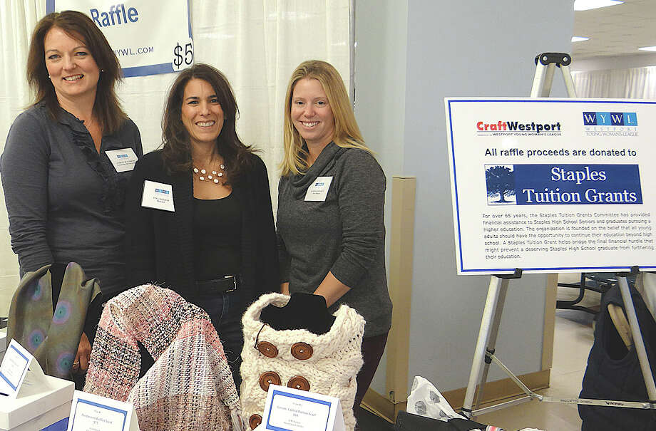 Westport Young Woman's League Community Service Co-Chairwoman Lindsay Blackburn, member Tina Meehan and member Alison Schwartz at the league's 38th annual CraftWestport on Saturday. Photo: Mike Lauterborn / Westport News contributed