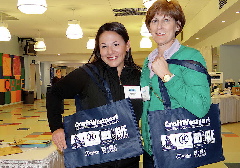 Westport Young Woman's League member Jenn Blum and Admissions Committee Co-Chairwoman Dot Baliban at the league's 38th annual CraftWestport event at Staples High School. Photo: Mike Lauterborn / Westport News contributed