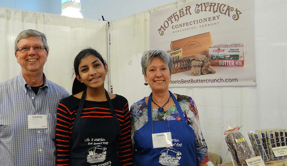 Ron and Jacki Baker of Mother Myricks Confectioners, with Nikhita Shankar, at the 38th annual CraftWestport at Staples High School. Photo: Mike Lauterborn / Westport News contributed
