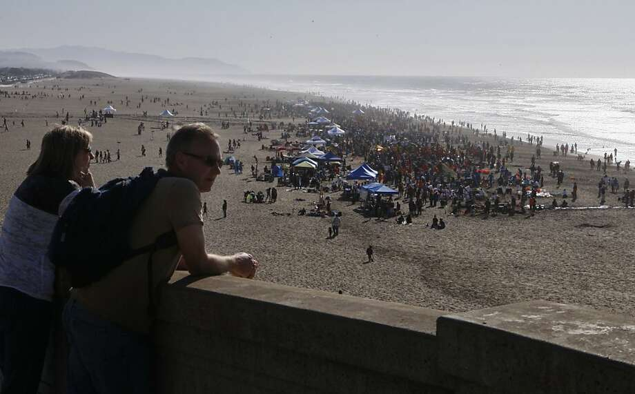 John and Christine McLarty of Santa Rosa enjoy the view of Ocean Beach and the Leap Sand Castle Contest from Point Lobos Ave in San Francisco, Calif. on Saturday, Nov. 9, 2013. Photo: Raphael Kluzniok, The Chronicle