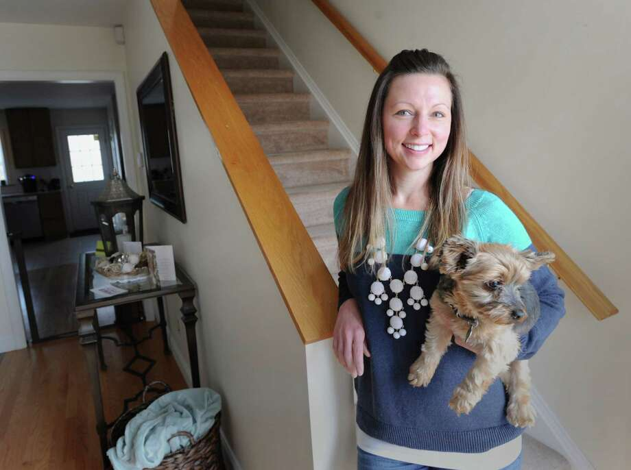 Krista Way with her Yorkshire terrier, Toby, in her Greenwich home, Saturday, Nov. 9, 2013. Way, who is single, lives in the Chickahominy section of Greenwich in a duplex. Photo: Bob Luckey / Greenwich Time