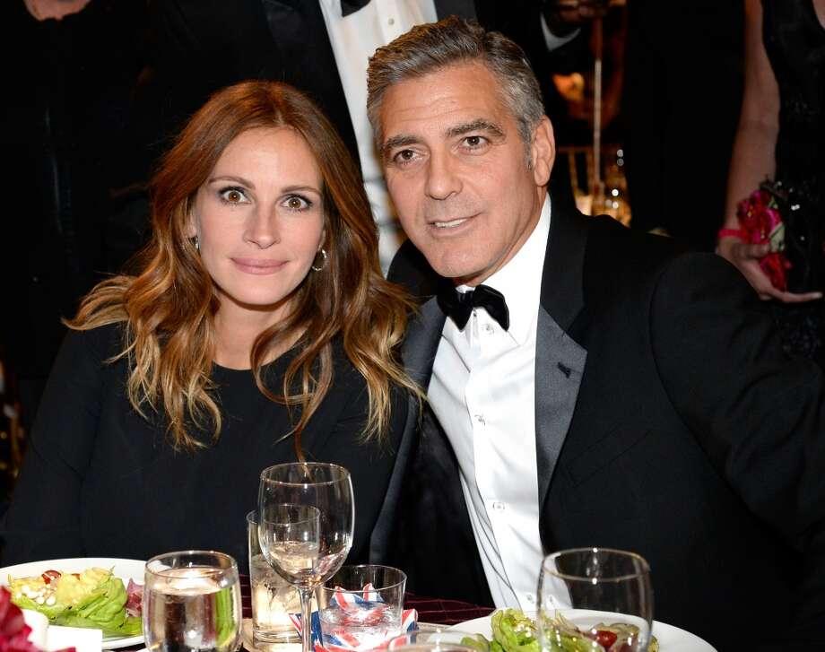 Actors Julia Roberts (L) and George Clooney attend the 2013 BAFTA LA Jaguar Britannia Awards presented by BBC America at The Beverly Hilton Hotel on November 9, 2013 in Beverly Hills, California. Photo: Kevork Djansezian/BAFTA LA, Getty Images For BAFTA LA