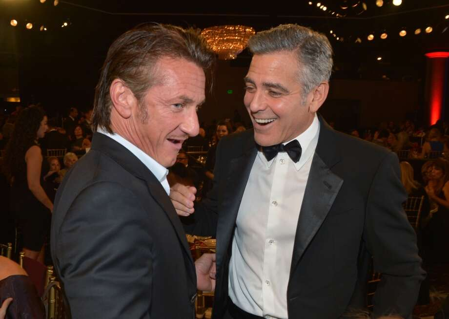 Actor Sean Penn (L) and actor George Clooney attend the 2013 BAFTA LA Jaguar Britannia Awards presented by BBC America at The Beverly Hilton Hotel on November 9, 2013 in Beverly Hills, California. Photo: Michael Buckner/BAFTA LA, Getty Images For BAFTA LA