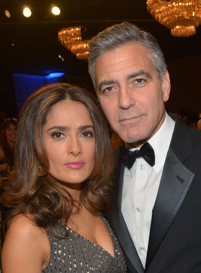 Actress Salma Hayek (L) and actor George Clooney attend the 2013 BAFTA LA Jaguar Britannia Awards presented by BBC America at The Beverly Hilton Hotel on November 9, 2013 in Beverly Hills, California. Photo: Michael Buckner/BAFTA LA, Getty Images For BAFTA LA