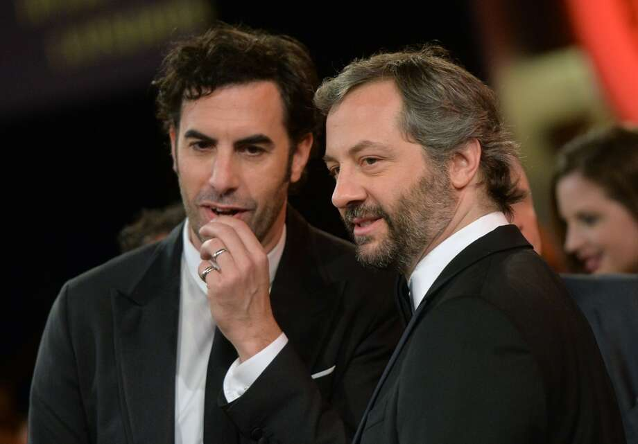 Actor Sacha Baron Cohen (L) and director Judd Apatow attend the 2013 BAFTA LA Jaguar Britannia Awards presented by BBC America at The Beverly Hilton Hotel on November 9, 2013 in Beverly Hills, California. Photo: Michael Buckner/BAFTA LA, Getty Images For BAFTA LA