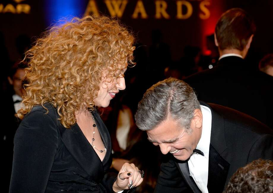 Actors Alex Kingston (L) and George Clooney attend the 2013 BAFTA LA Jaguar Britannia Awards presented by BBC America at The Beverly Hilton Hotel on November 9, 2013 in Beverly Hills, California. Photo: Kevork Djansezian/BAFTA LA, Getty Images For BAFTA LA